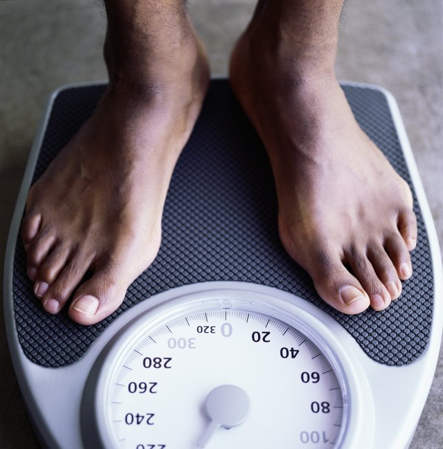 Feet of man on weight scale