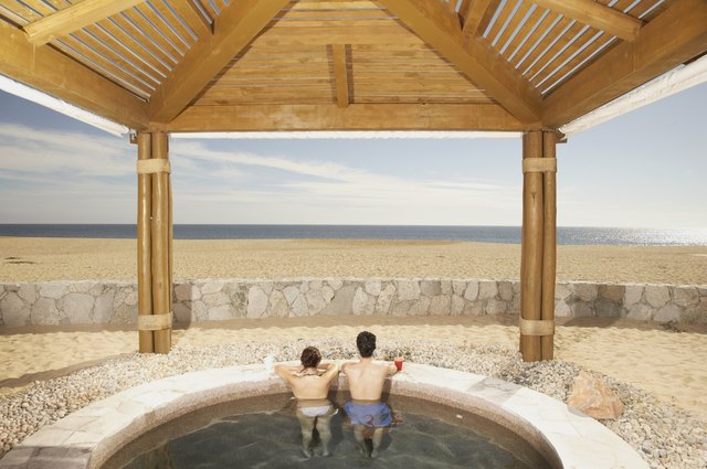 Couple in hot tub outdoors at beach resort