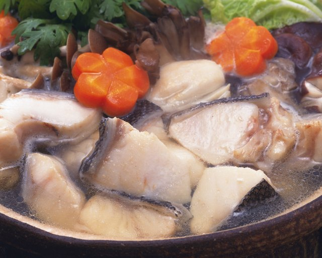 Vegetable and cods in pot, high angle view