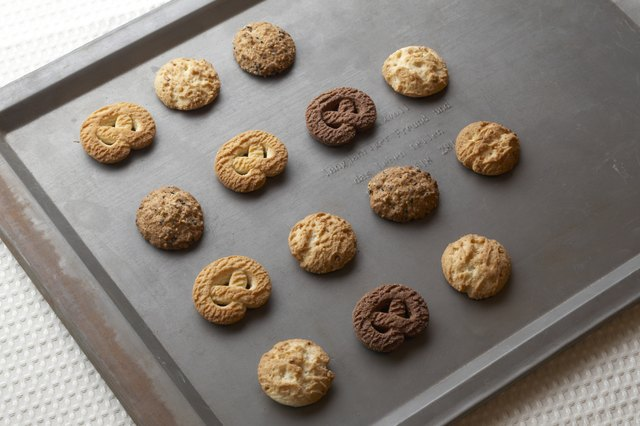 Cookies on baking tray, high angle view