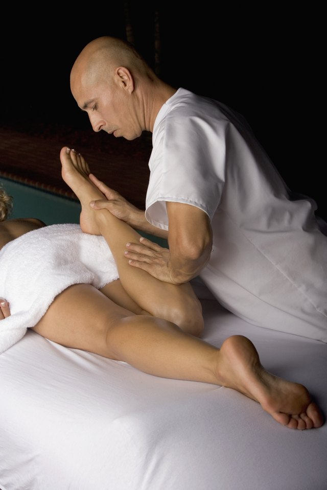 High angle view of a young woman getting a massage from a massage therapist