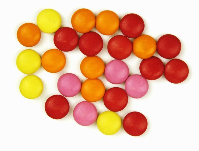 Colorful red, orange, yellow and pink sugarcoated sweets