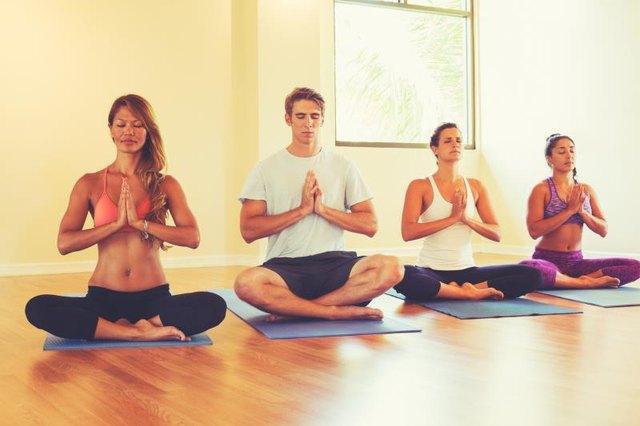 Group of People Relaxing and Meditating in Yoga Class. Wellness and Healthy Lifestyle.