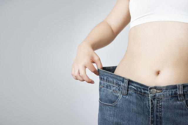 Woman in jeans of large size, concept weight loss