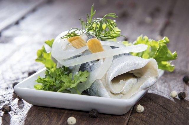Fresh made Rollmop on a plate