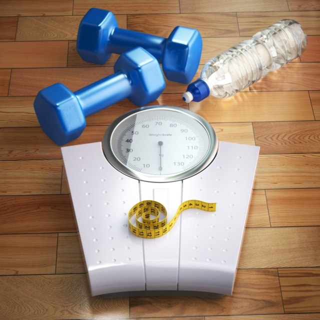 Fitness and weight loss concept. Weigh scales