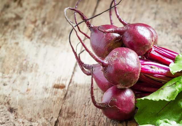 Bunch of fresh organic beets with tops