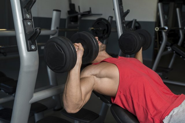 Man Pressing Dumbbells