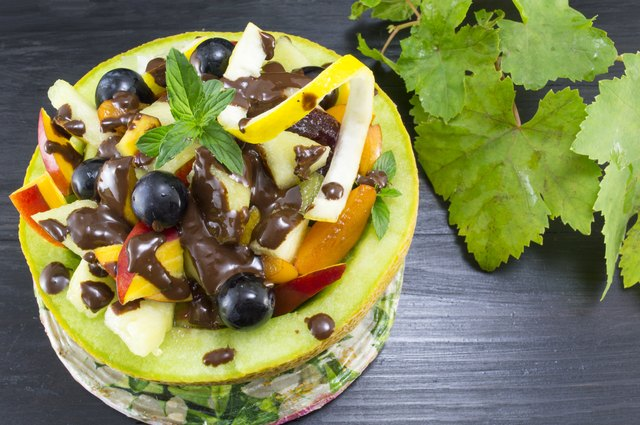 Healthy unique fruit salad served with chocolate