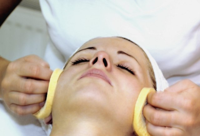 Close-up of a person's hand wiping a mid adult woman's face