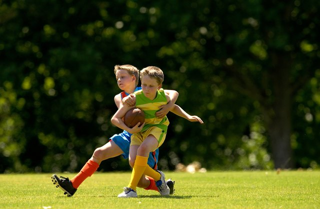 Young football player tackles opposition