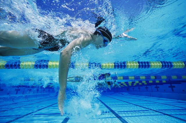 Swimmers Racing in Pool
