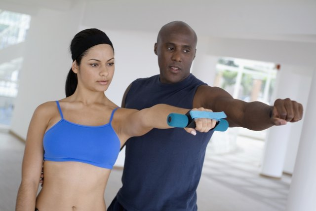 Man and young woman training side by side, tilt