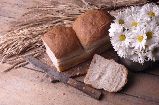 Daisies in rustic jug with bread loaf