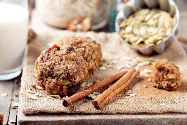 Oat and peanut butter cookies with pumpkin seeds,cinnamon,milk.