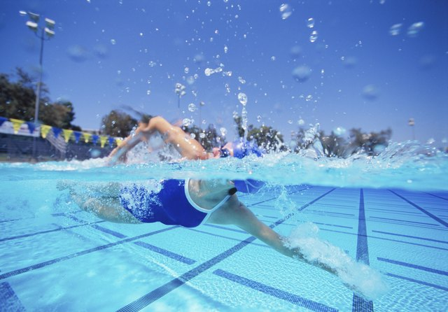 Female swimmer in United States swimsuit swimming pool