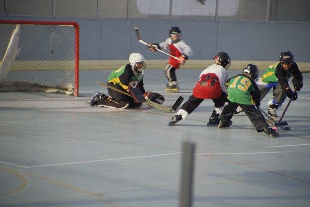 Boys playing rollerhockey