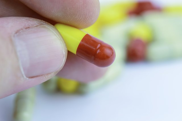 Picking up a yellow and red capsule