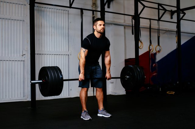 Young man during deadlift workout