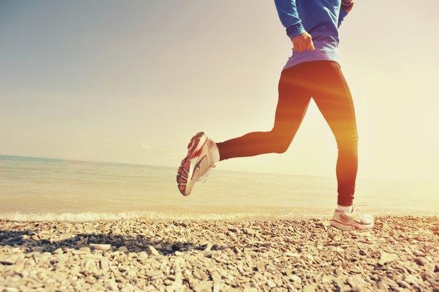 Runner athlete running on seaside
