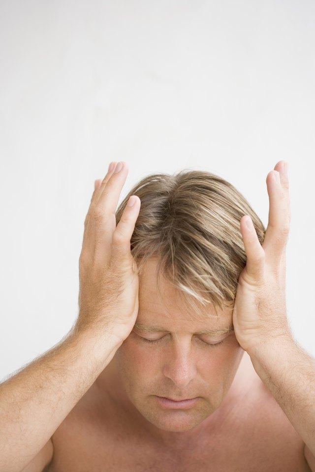 Headache & Nausea After a Fall on My Back