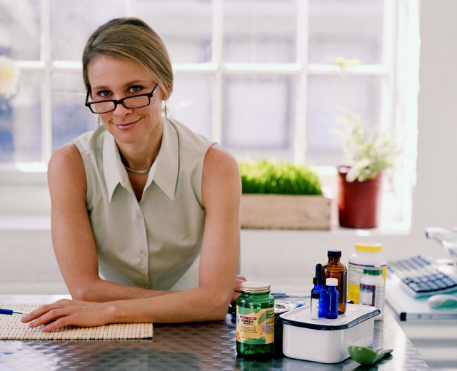 Woman at desk with medication