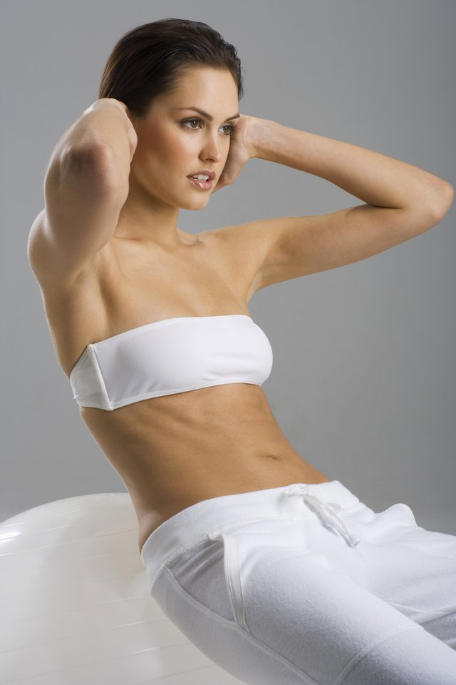 Woman doing crunches on exercise ball