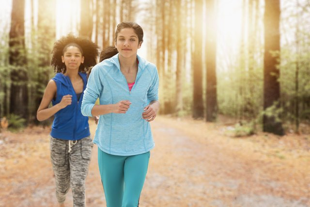 USA, New Jersey, Portrait of teenage girls (14-15, 16-17) running