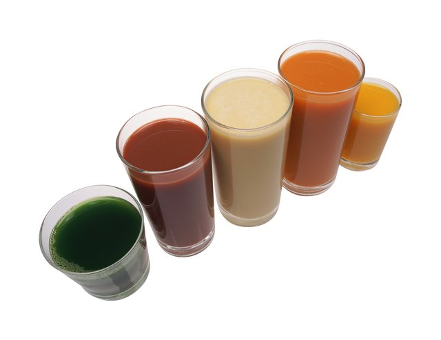 Glasses of fruit and vegetable juices, arranged in row