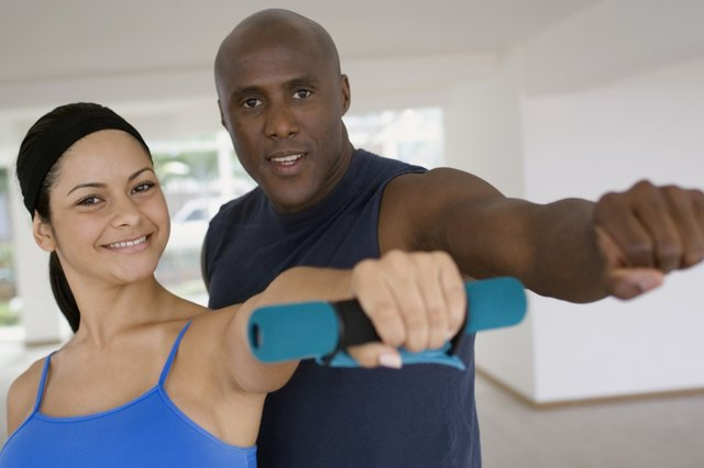 Man and young woman training, close-up