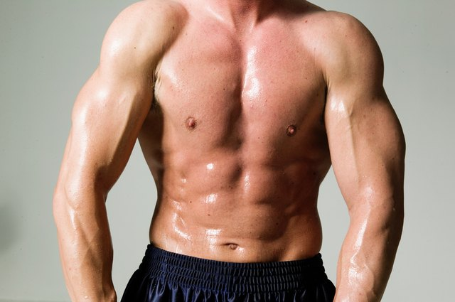 Man flexing muscles, mid section