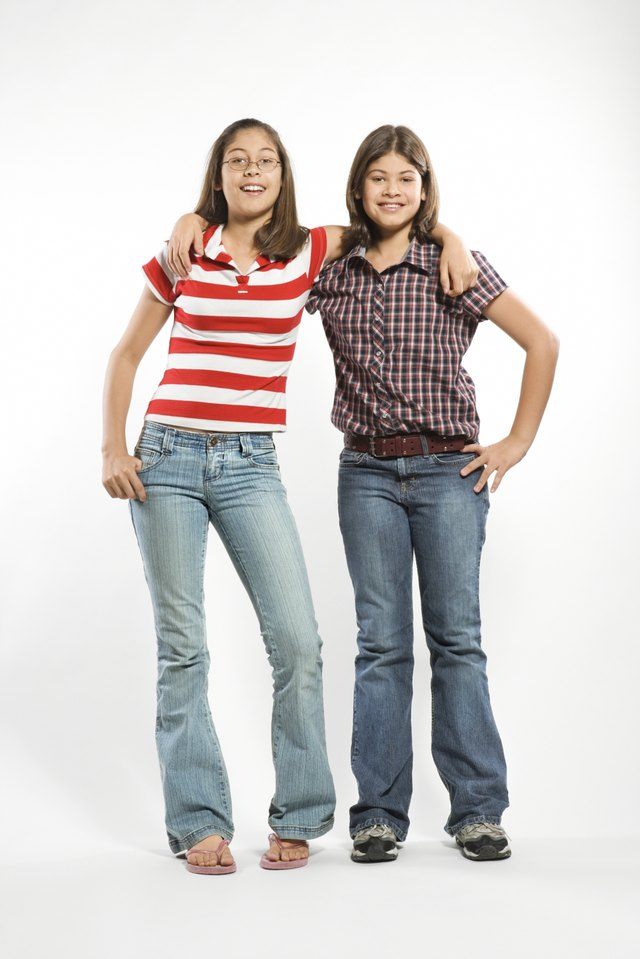 Teen sisters posing together