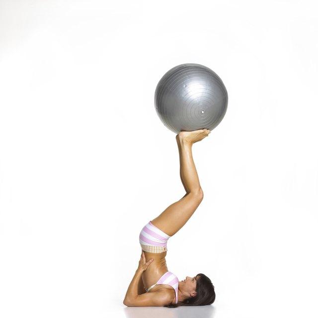 Woman Balancing Exercise Ball on Feet