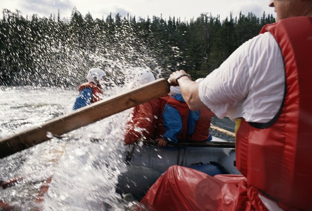 Group of people in canoe, close-up