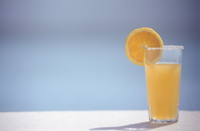Orange juice in glass with slice of orange,  ground view, copy space