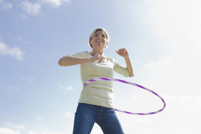 Woman with a plastic hoop toy