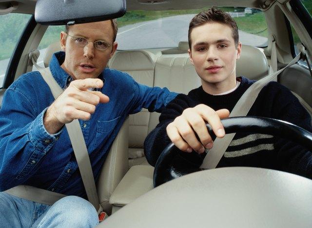 Man Teaching a Boy How to Drive