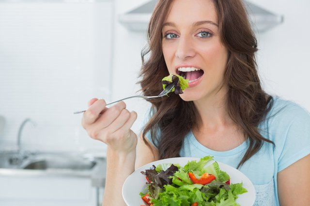 Brunette eating healthy salad