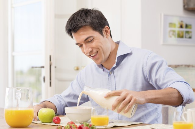 Man Having Breakfast With Milk