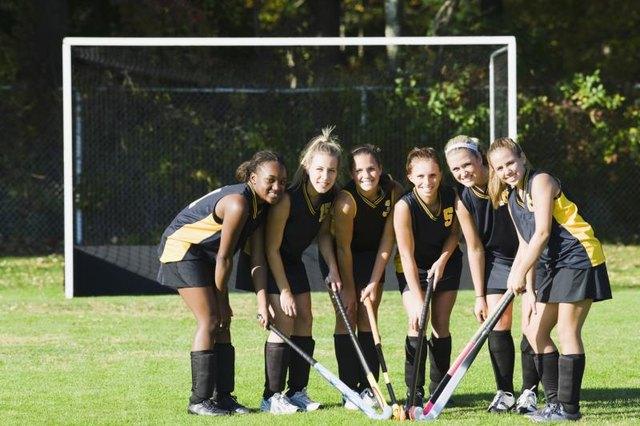 Female hockey players in a field