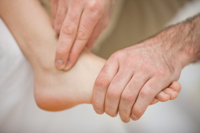 Physiotherapist massaging a barefoot