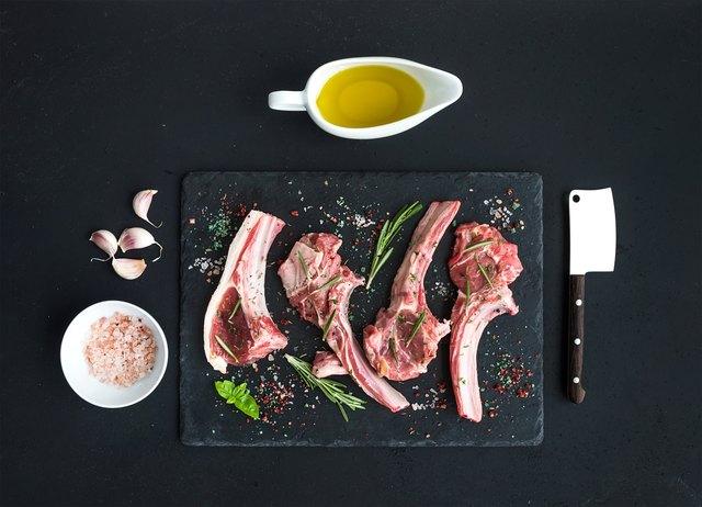 Raw lamb chops. Rack of Lamb with garlic, rosemary and