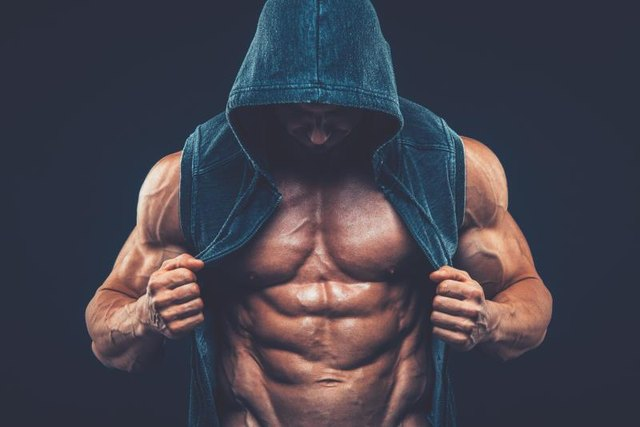 Man with muscular torso. Strong Athletic Man Fitness Model Torso showing six pack abs fighter  kickbox boxer boxing fight