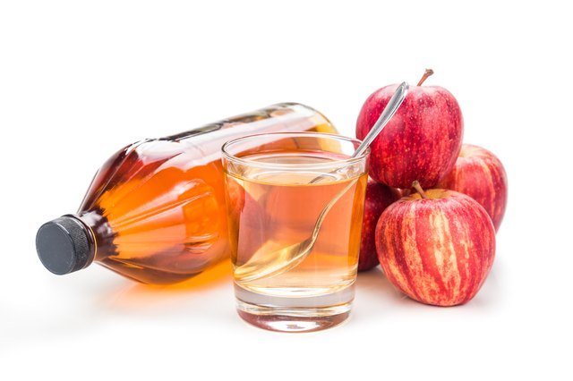Apple cider vinegar with fresh apple as prop, healthy drink