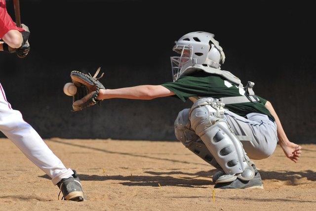 Teen boy plays baseball catcher