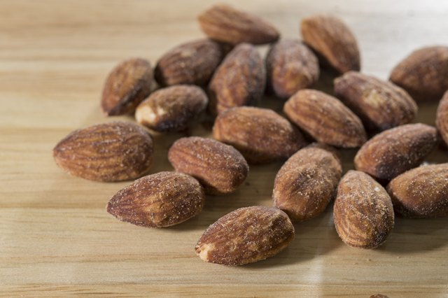 Almond on wood background