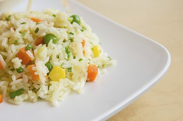 fried rice with butter on white dish