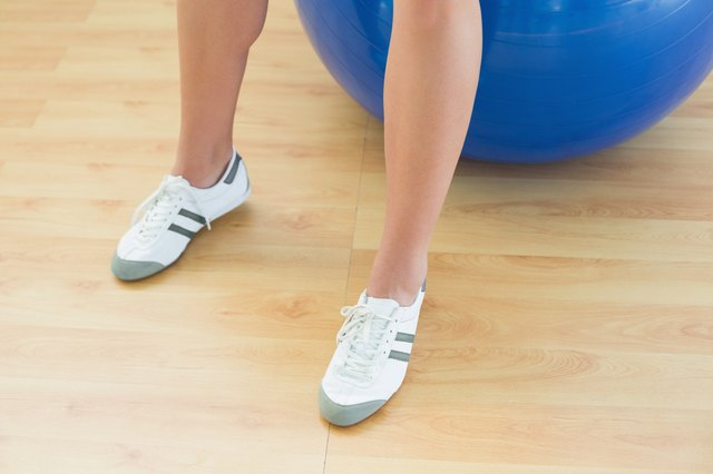 Woman's legs and exercise ball