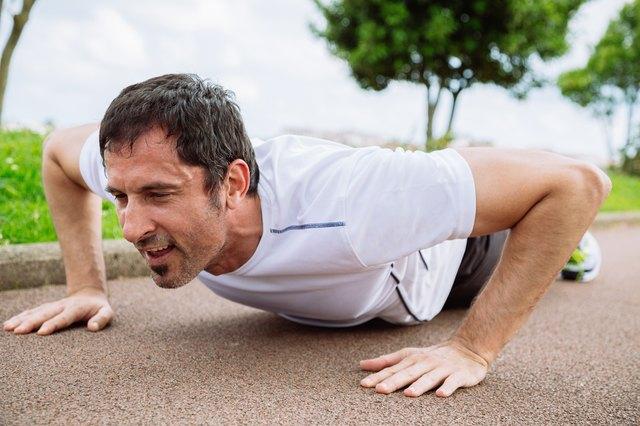 Man doing pushups outdoors