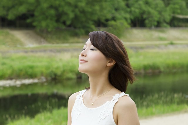 Asian girl beside river. breath and relax
